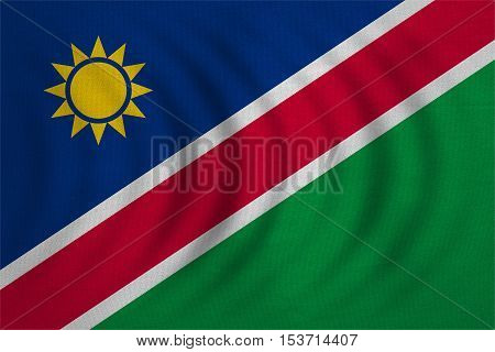 Namibian national official flag. African patriotic symbol banner element background. Correct colors. Flag of Namibia wavy with real detailed fabric texture accurate size illustration