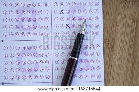 lottery ticket and pen on wooden table