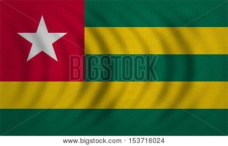 Togolese national official flag. African patriotic symbol banner element background. Correct colors. Flag of Togo wavy with real detailed fabric texture accurate size illustration