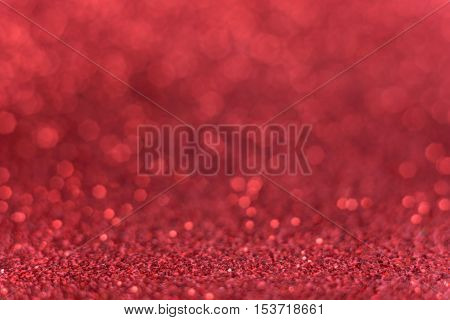 Christmas background. Shiny red abstract background. Glitter background