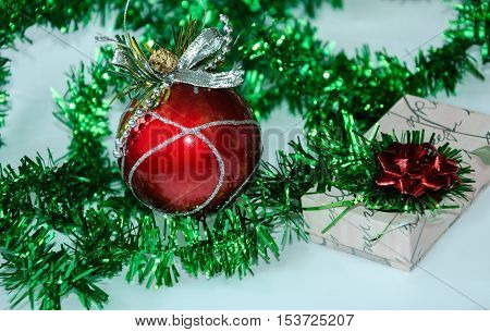 beautiful holiday tinsel for Christmas or New Year background with green fir