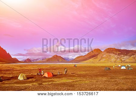 Travel to Iceland. Beautiful Icelandic landscape with mountains, sky and clouds. Trekking in national park Landmannalaugar. Sunrise in Camping near Alftavatn lake.