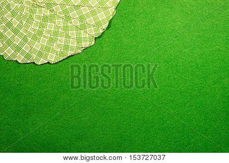 Cards fan on green casino felt background. Copy space on the felt table