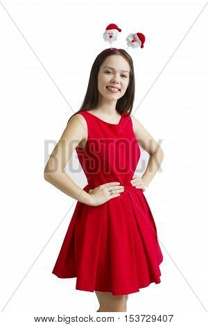 Portrait of beautiful young woman in red dress holding gift box isolated over white background.