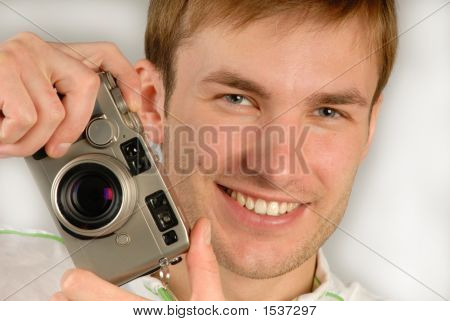 Young Man With  Camera In Hands, Close Up
