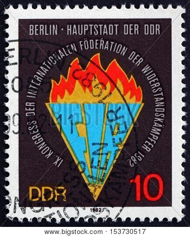 GERMANY - CIRCA 1982: a stamp printed in Germany shows Emblem International Federation of Resistance Fighters 9th Congress Berlin circa 1982