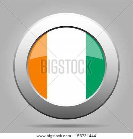 National flag of Ivory Coast. Shiny metal gray round button with shadow.