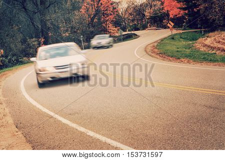 Cars driving around the curve, motion blur on cars