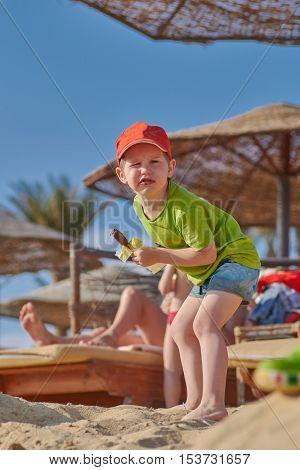 Happy Child Boy Happy Wating Ice Cream at the Beach