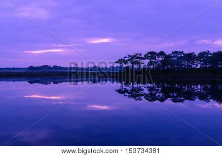 Reflection of Sunset in the Lake at Phu Kradueng National Park. twilight time.