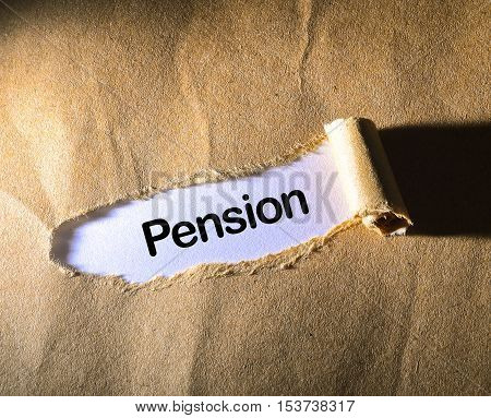 Pension word on the brown torn paper