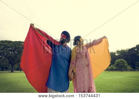 Indian Couple Superheroes Love Concept
