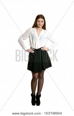 Young beautiful woman in black skirt and heels standing full length, isolated on white background