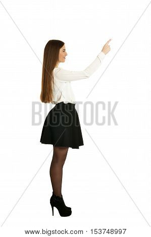 Portrait of a beautiful woman pointing up
