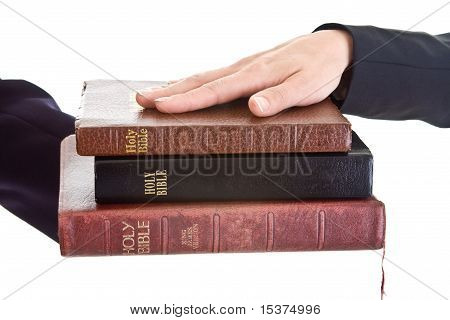 Woman's Hand Stack Of Bibles Isolated Background