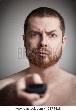 Zapping - Annoyed Man With Tv Remote Control
