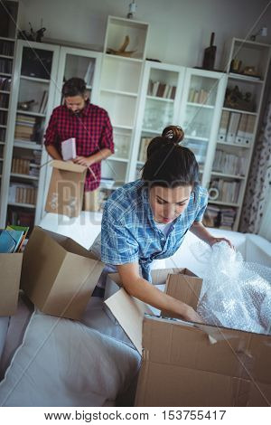 Couple unpacking cartons in their new house