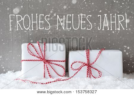 German Text Frohes Neues Jahr Means Happy New Year. Two White Christmas Gifts Or Presents On Snow. Cement Wall As Background With Snowflakes. Modern And Urban Style.