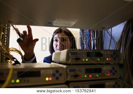 Attentive technician working in server room