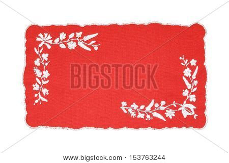 Embroidered red and white tablecloth isolated on white background
