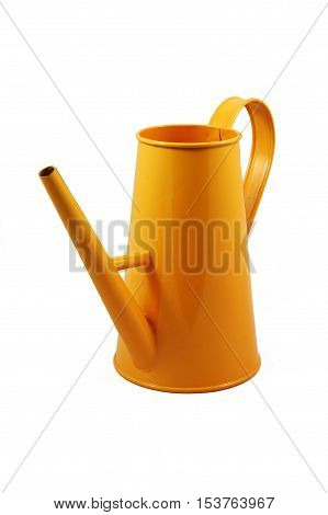 Watering can for flowers, in orange paint, made of metal, isolated on white background