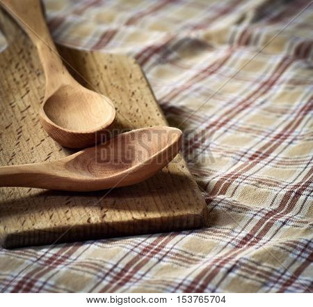 Background traditional ancient wooden spoon on the plate