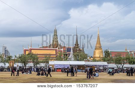Bangkok Thailand - October 26 2016: Grand palace on cloudy day surround by black dress crowd to mourn the pass away King Bhumibol Adulyadej.