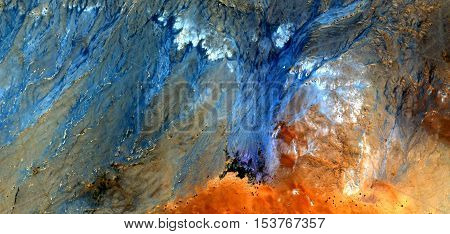 Abstract photography of landscapes of deserts of Africa from the air, red on blue