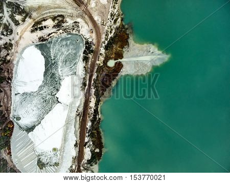 Aerial view - blue water in pond, sandy career