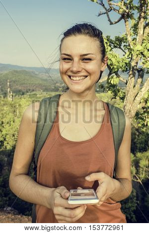 Girl Using Mobile Phone Outdoors Concept