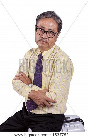 head shot of asian business man sitting on traveling luggage with bored face isolated white background