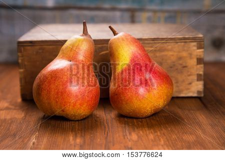 two delicious raw ripe pears on wooden background