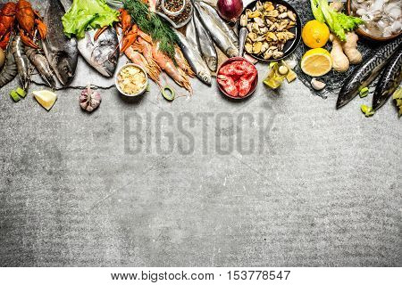 Different Fish, Shrimp And Shellfish With Slices Of Lemon