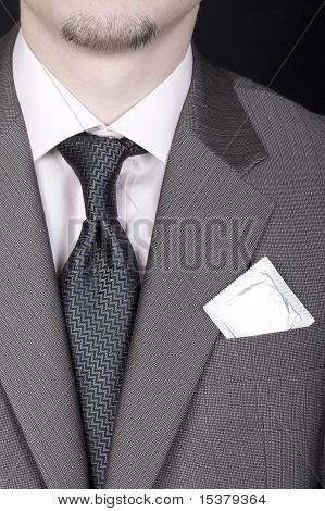 Young Man In Business Suit With Condom In Pocket