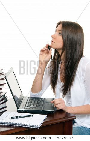 Woman Sitting With Laptop With Pen In Hand