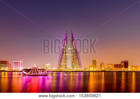 MANAMA, BAHRAIN - OCT 28, 2016: Beautiful view of the Seafront with illuminated World Trade Center and other high rise buildings in the city.