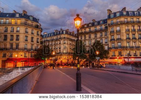 Street Cafes On The Ile Saint Louis In Paris At Night