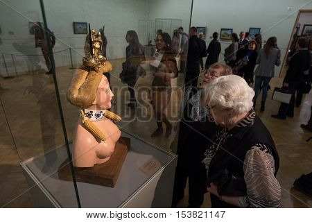 Saint-Petersburg Russia - October 28 2016: Exhibition of works by Salvador Dali in the State Hermitage. Spectator consider sculpture Retrospective Female Bust