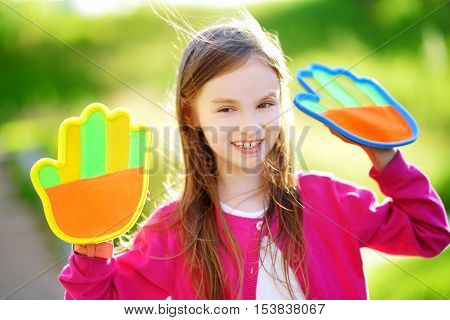 Cute Little Girl Playing A Ball Catching Game With Sticky Velcro Palm Pads