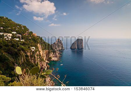 Italy Tour - Capri island - beautiful view of Capri Faraglioni and blue sea