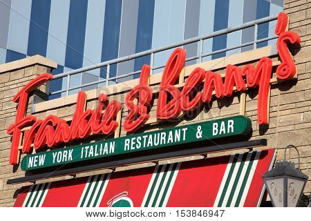 Carmarthen, Wales, UK, October 22, 2016 : Frankie & Benny's logo advertising sign outside one of it's restaurants in St Catherine Street