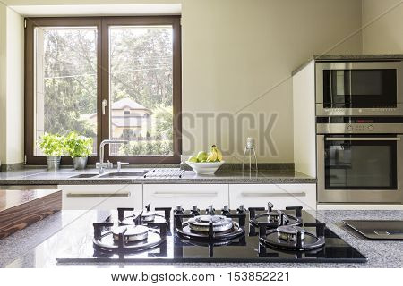 Kitchen Granitic Worktop With A Cooker