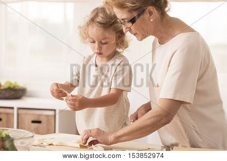 Grandmother Making Cookies With Grandchild