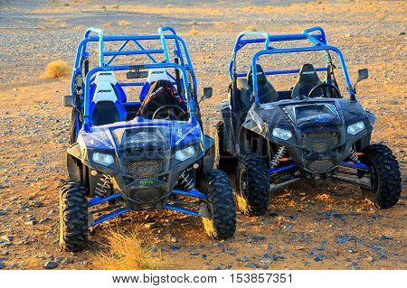 Merzouga Morocco - Feb 25 2016: Two blue Polaris RZR 800 without pilot in Morocco desert near Merzouga. Merzouga is famous for its dunes the highest in Morocco.