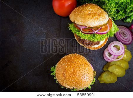 Big Sandwich - Hamburger Burger With Beef, Pickles, Tomato And Tartar Sauce On Black Background. Top