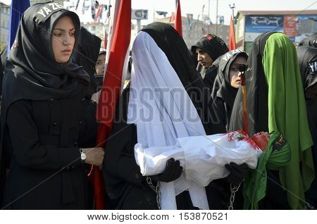 Istanbul Turkey - October 11 2016: Shia Muslim women mourn during an Ashura. Turkish Shia Muslims mourning for Imam Hussain. Caferis take part in a mourning procession marking the day of Ashura in Istanbul's Kucukcekmece district Turkey on October 11 2016