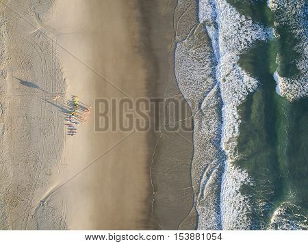 Aerial photo of surf life savers / lifeguards on Gold Coast beach. Queensland, Australia