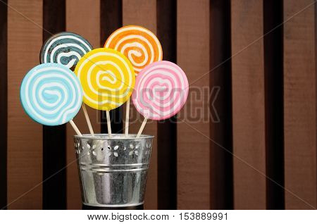 Five Lollipops Stacked In A Metal Pot