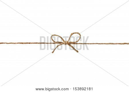 Closeup string or twine tied in a bow, isolated on white background. Holiday gift or present concept.