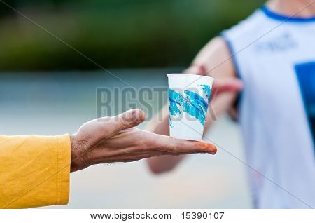 Hand With Water In Marathon